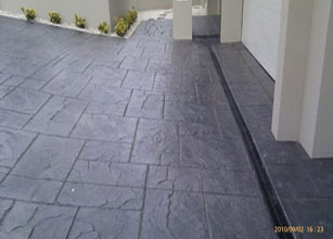 This Stamped Concrete Job Took Into Account The Important Aspect Of Drainage And A Great Modern Look