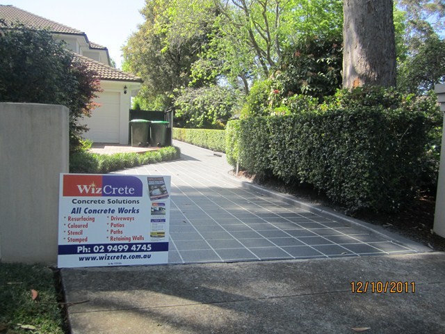 Concrete Resurfacing over pebblecrete driveway 31b